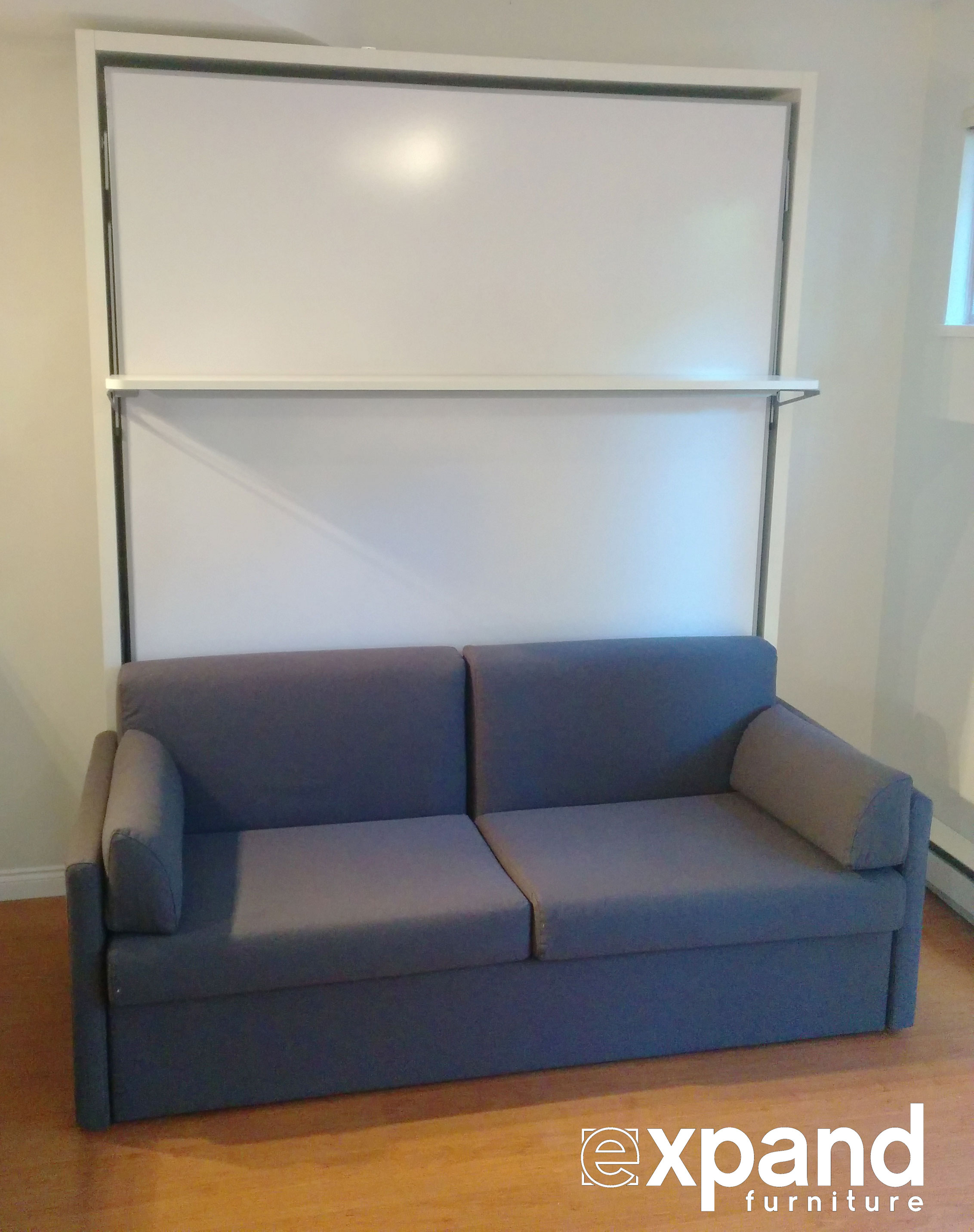 bore compatto murphy bed over sofa with floating shelf