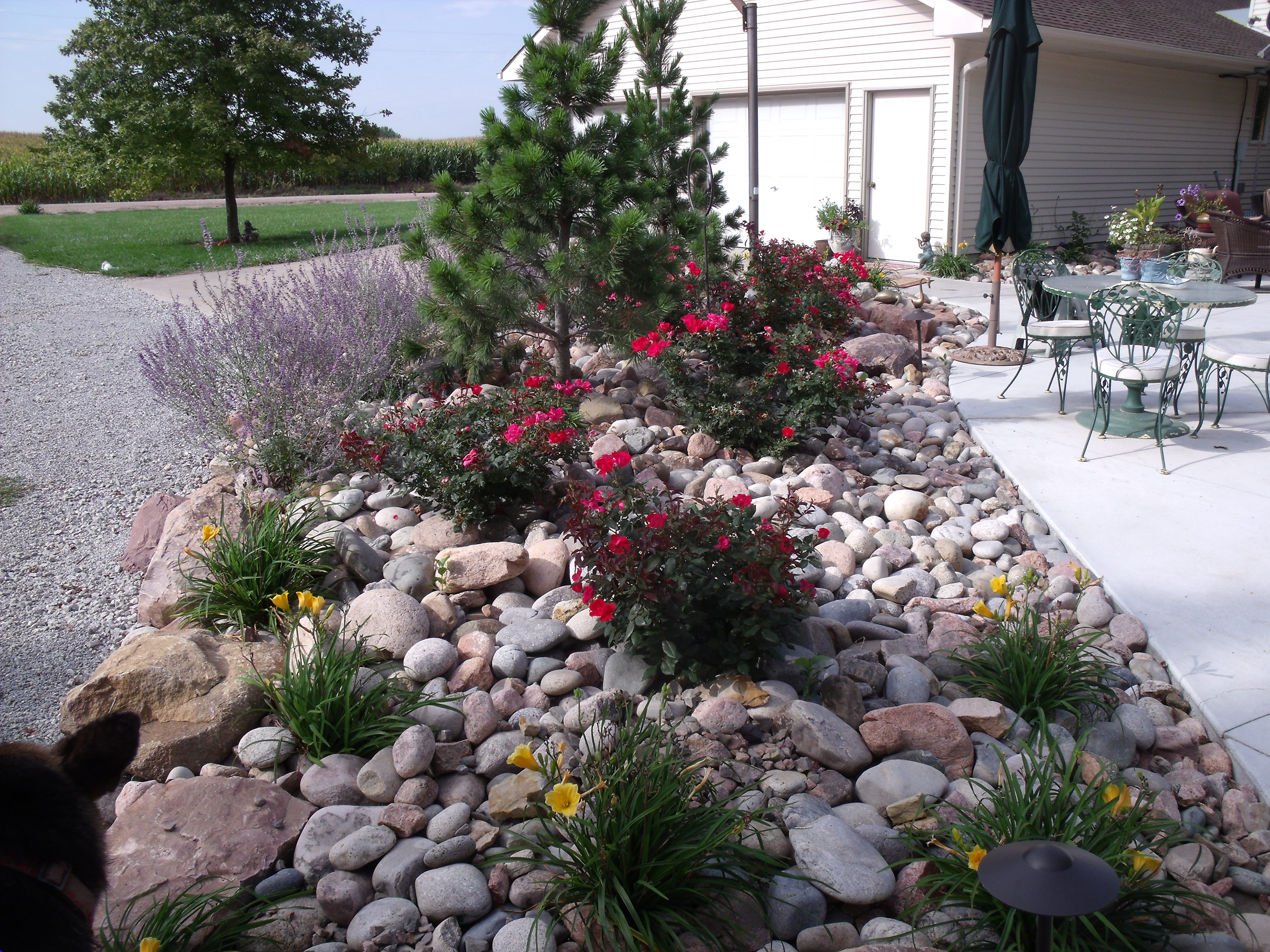 bore landscaping ideas with river rocks guidenice plan