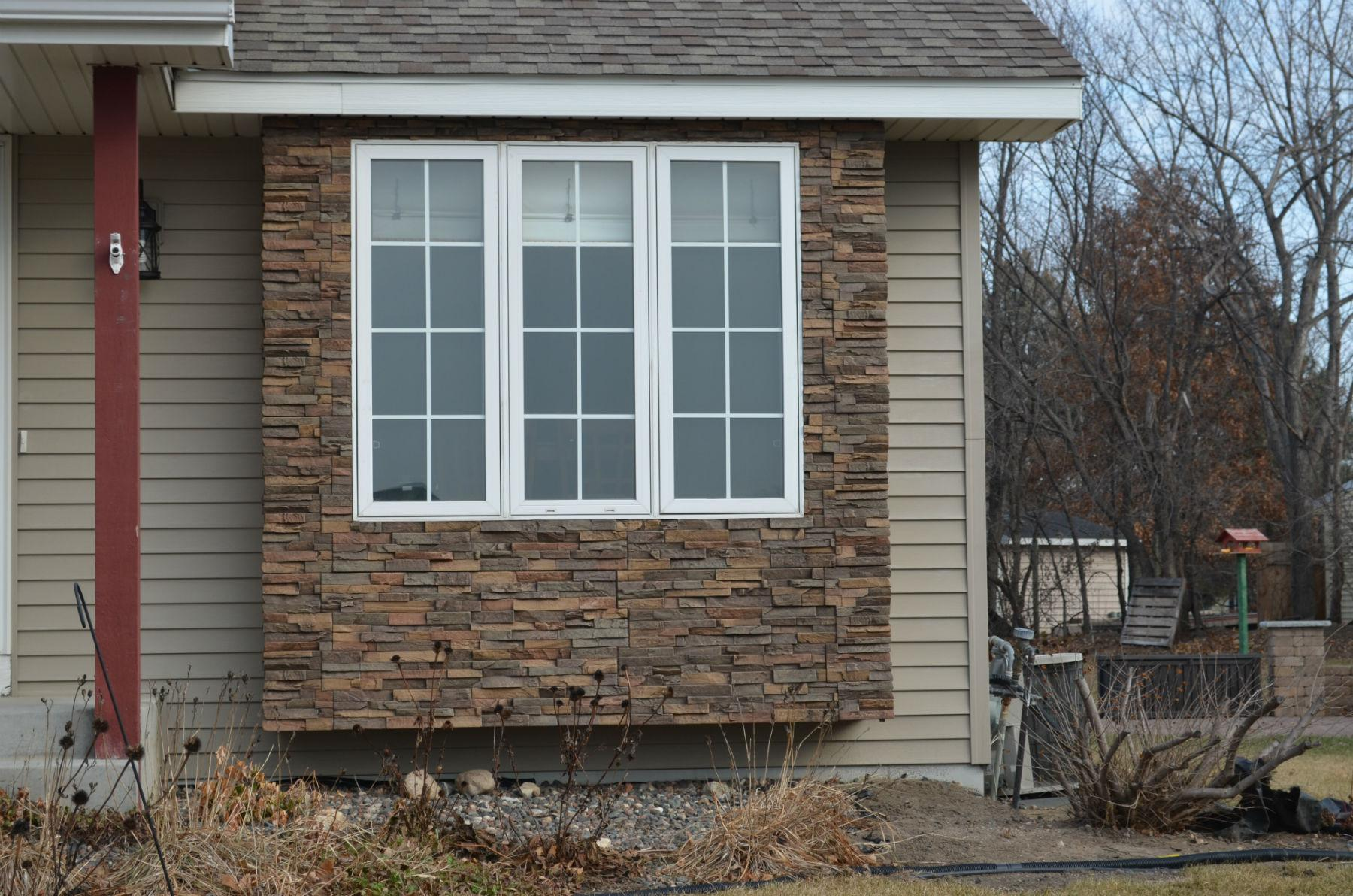 creative covering faux rock siding with stucco  the wooden houses