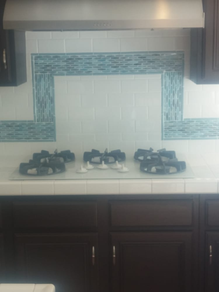 example of a 3x6 white subway tile with a green blue beach glass liner