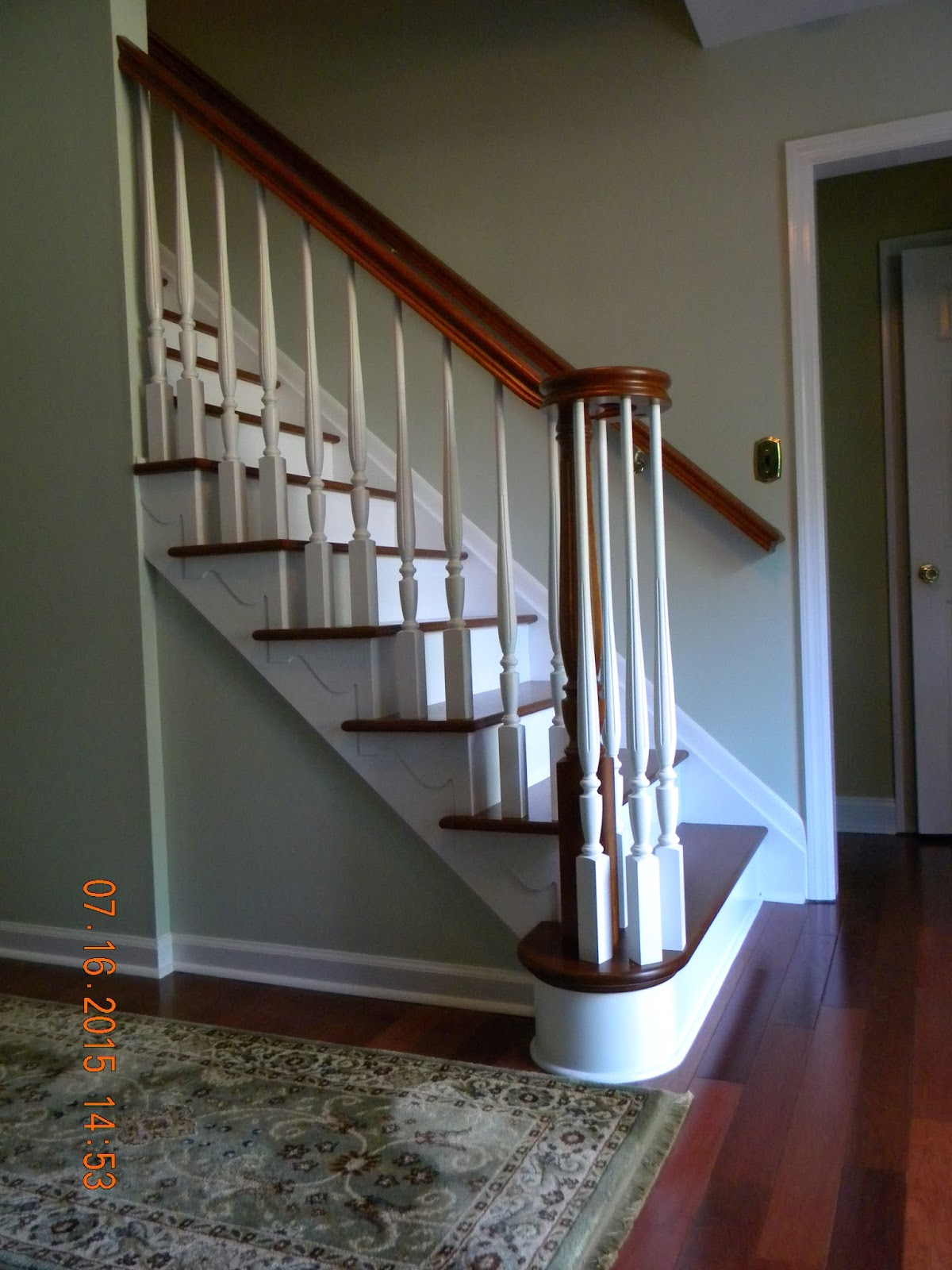example of a wood stairs and rails and iron balusters august 2015