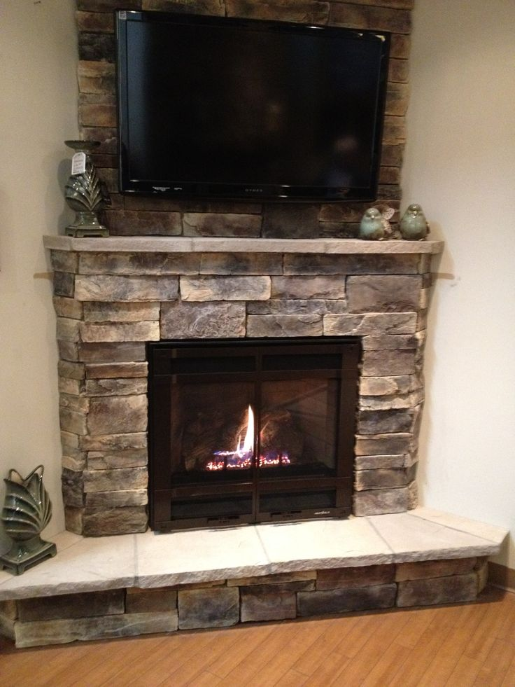 fresh decosee tv above fireplace