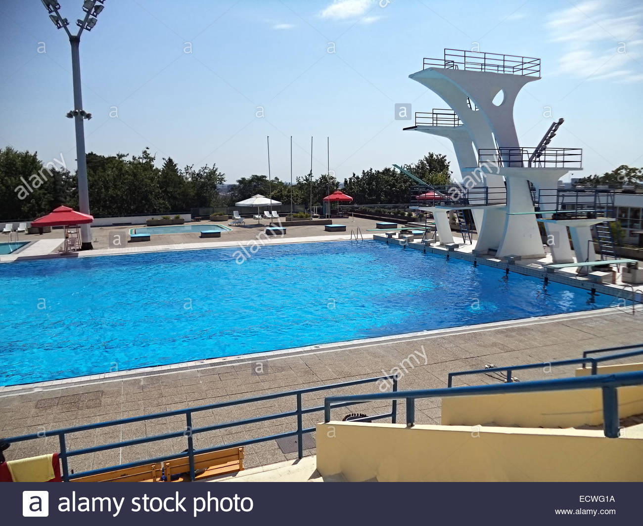 high diving board at a public swimming pool stock photo
