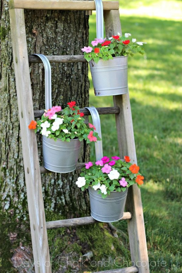Jazz Up Your Old Planters With Spray Paint And Your Medium