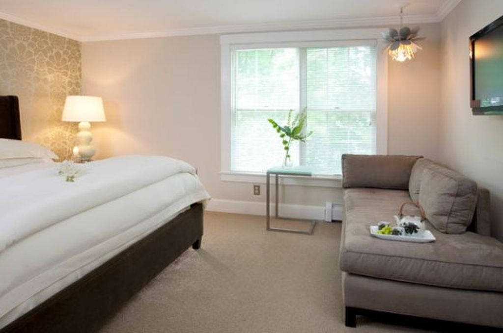 looking grey chaise lounge chair and white bed for cozy bedroom