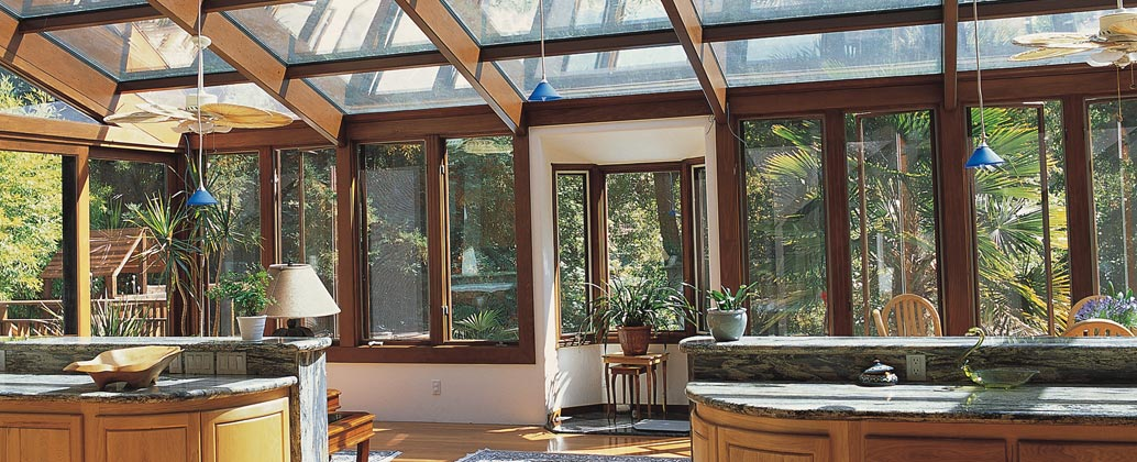looking straight glass roof sunroom with wood interior precision