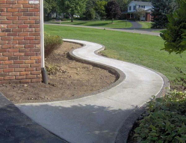 Our Favorite Winding Broom Finish Standard Concrete Walkway With Medium