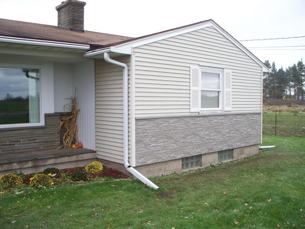 Popular Elegant Faux Rock Siding  The Wooden Housescovering Medium