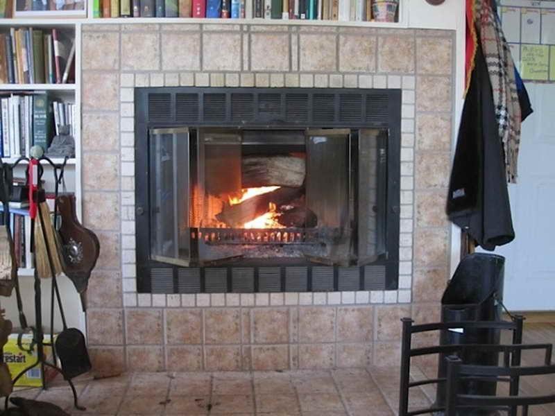 prefab woodburning fireplace bookshelve design