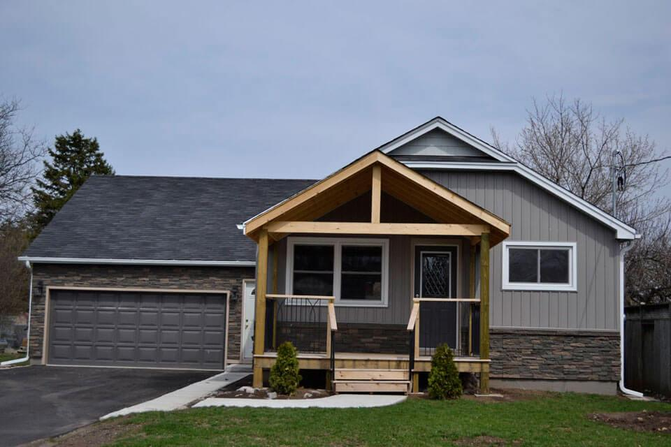 we share covering faux rock siding with stucco  the wooden houses