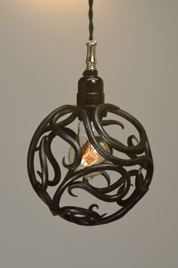 We share Hand Forged Scroll Ball Pendant Light