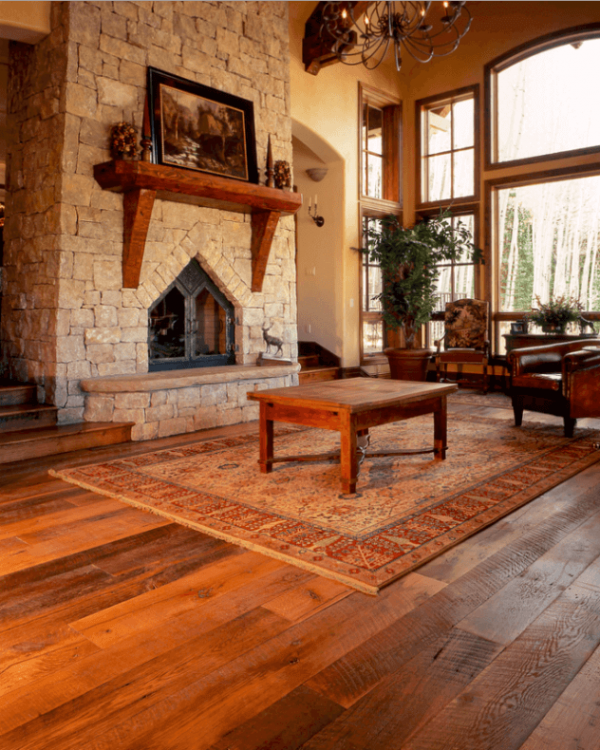 Antique Hardwood Flooring In A Tuscan Style Living Room Medium
