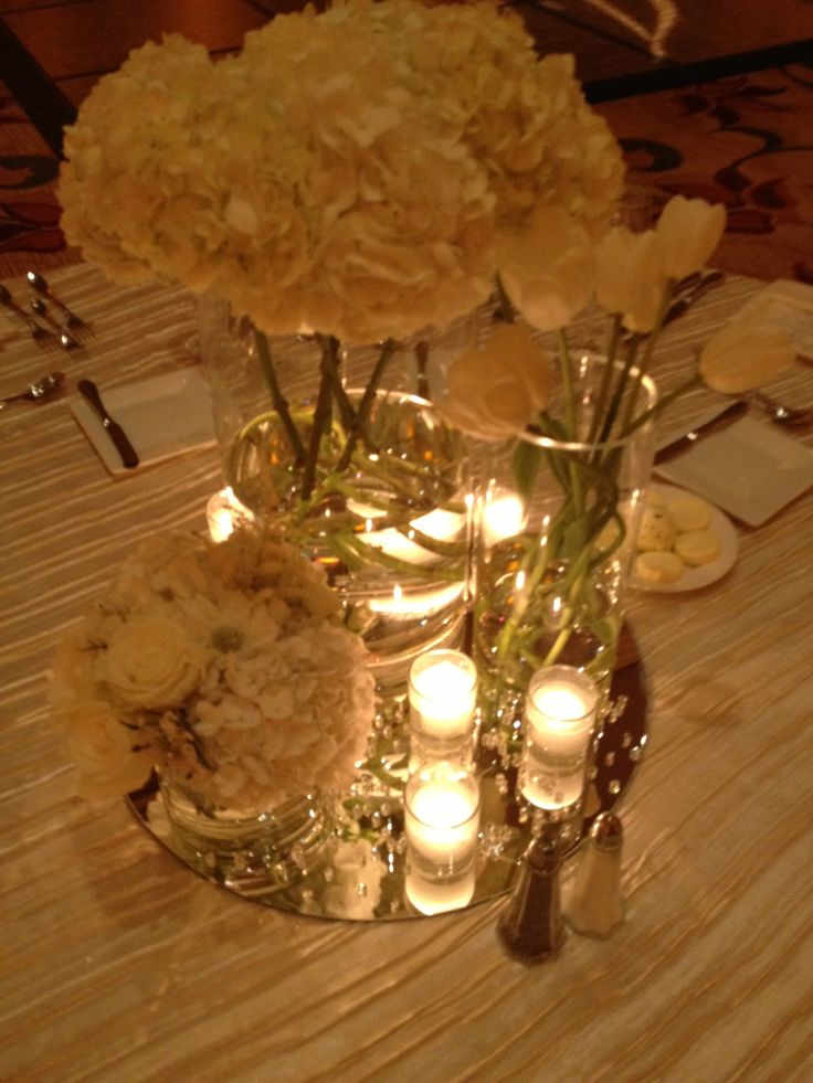 inspiration modern romantic centerpieces all white centered on mirrors