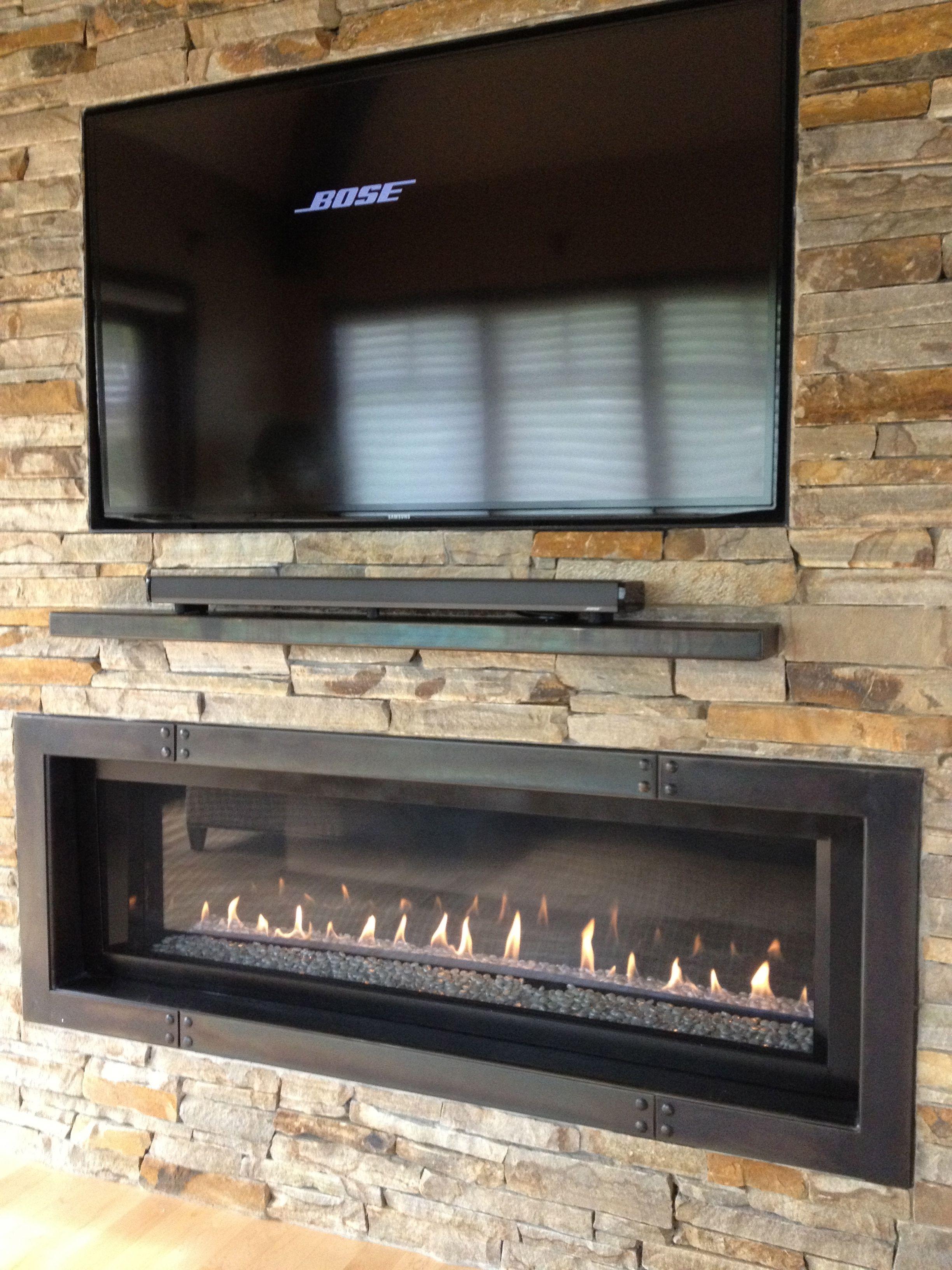 simply 60 tv with 5 ribbon fireplace plus custom iron surround