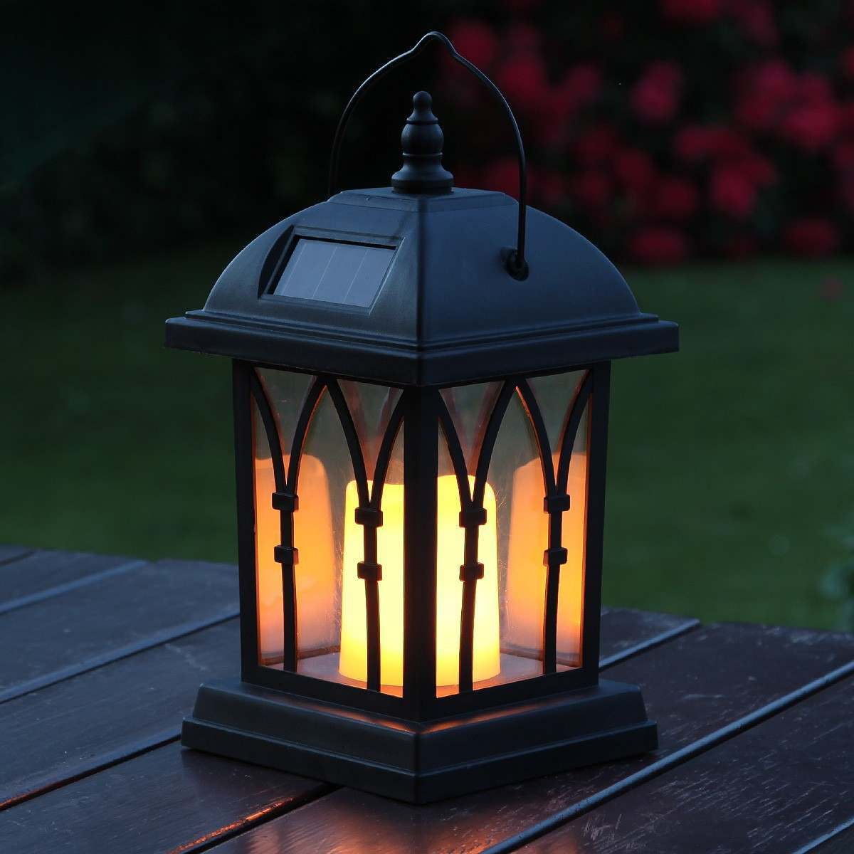 example of a black solar garden candle lantern flickering amber led 27cm