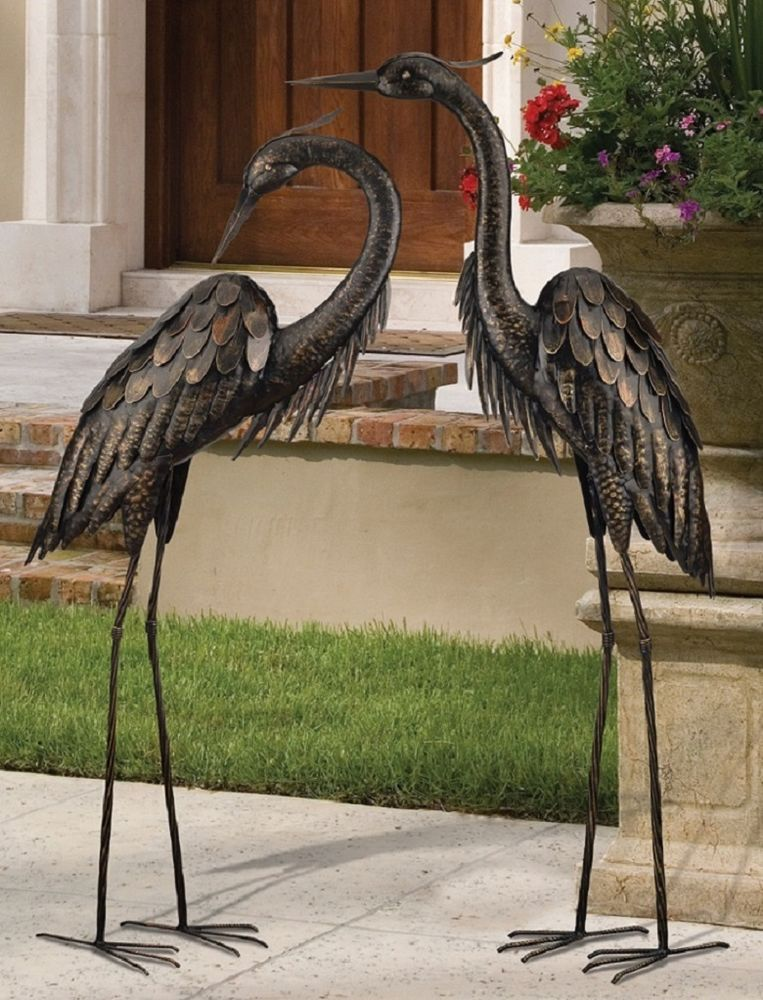 example of a bronze heron pair coastal metal garden statue crane bird