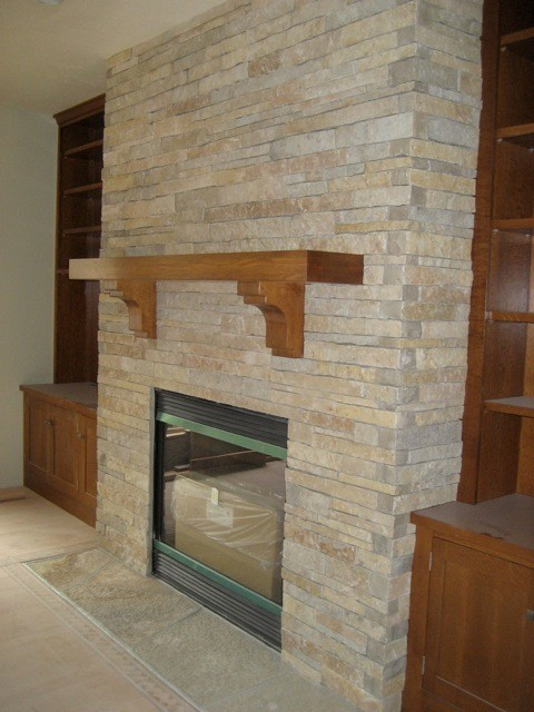 Example Of A Stacked Stone Fireplace Contemporary Indoor Fireplaces Medium