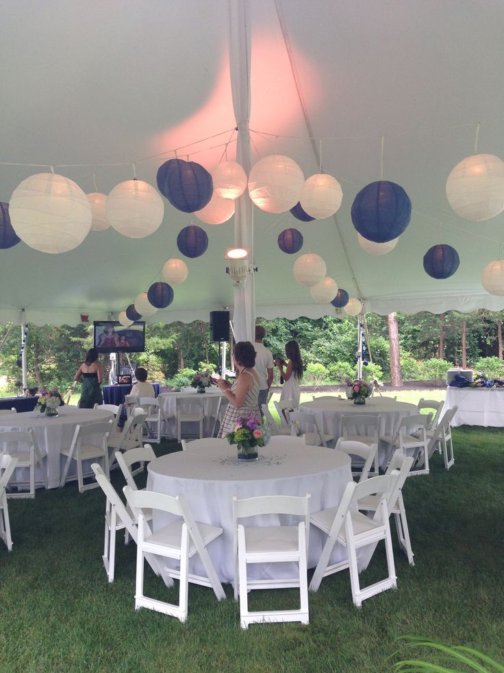 looking tented blue and white graduation partybackyard party