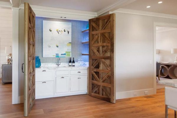 Simply Hidden Wet Bar With Carved Wood Doors Contemporary Kitchen Medium