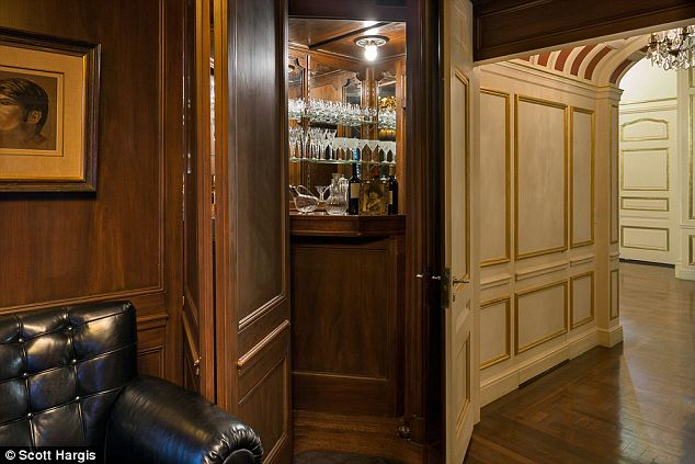 top the  27 million mansion with its own hidden bar where san