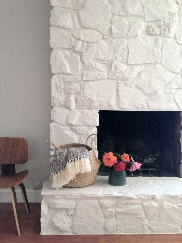 we share how to painting the stone fireplace whitediy projects