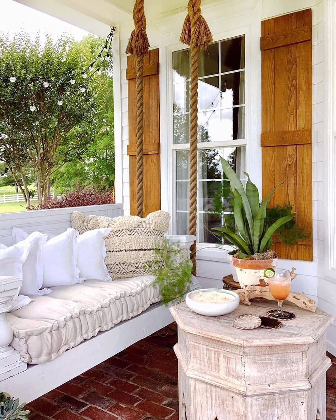 rethink your outdoor space by channeling this dreamy porch swing3